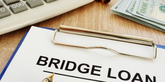 bridging loan written on notepad