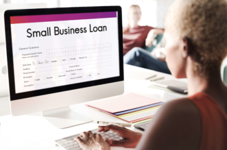 girl watching content about small business loan
