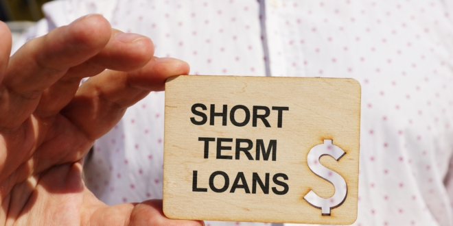 a hand holding a plate with shortterm loans writtens